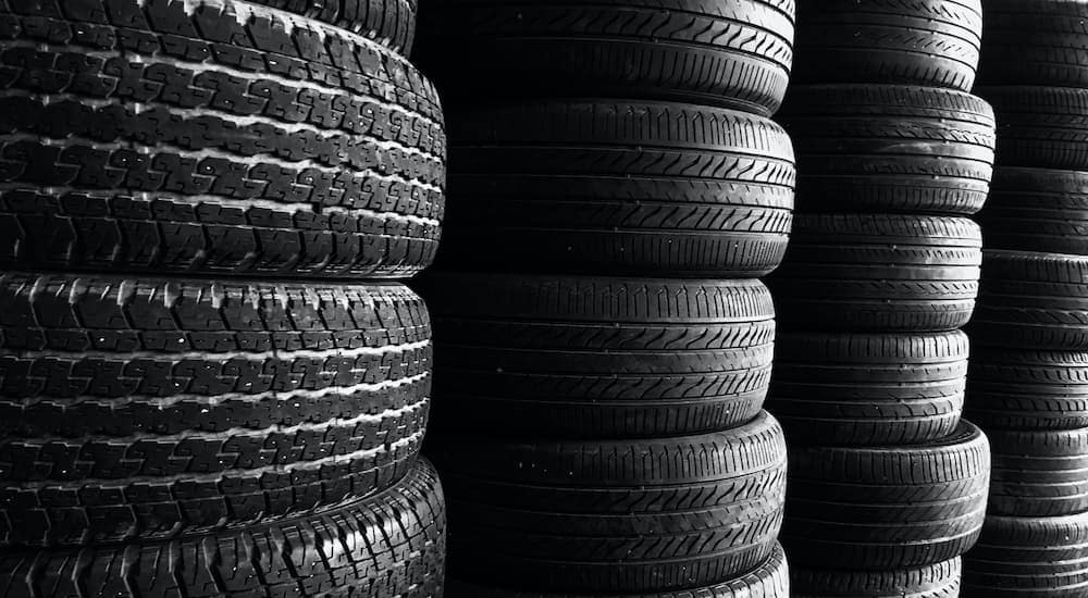 A close up shows multiple stacks of tires.