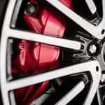 A close up shows a rad caliper and performance wheel.