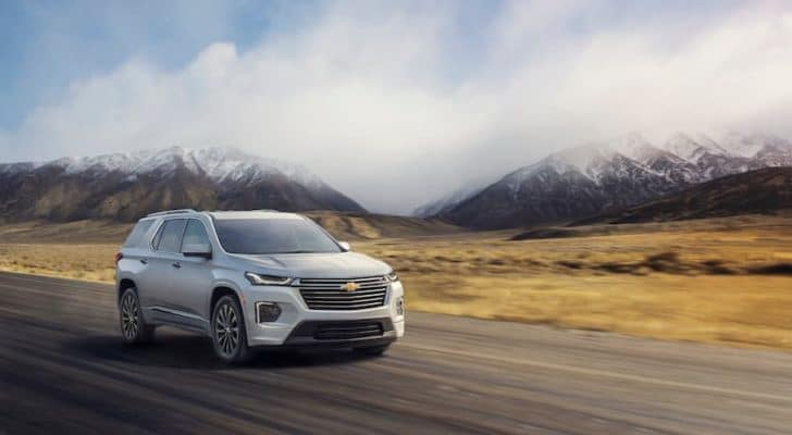 A white 2022 Chevy Traverse is angled right on an open road.