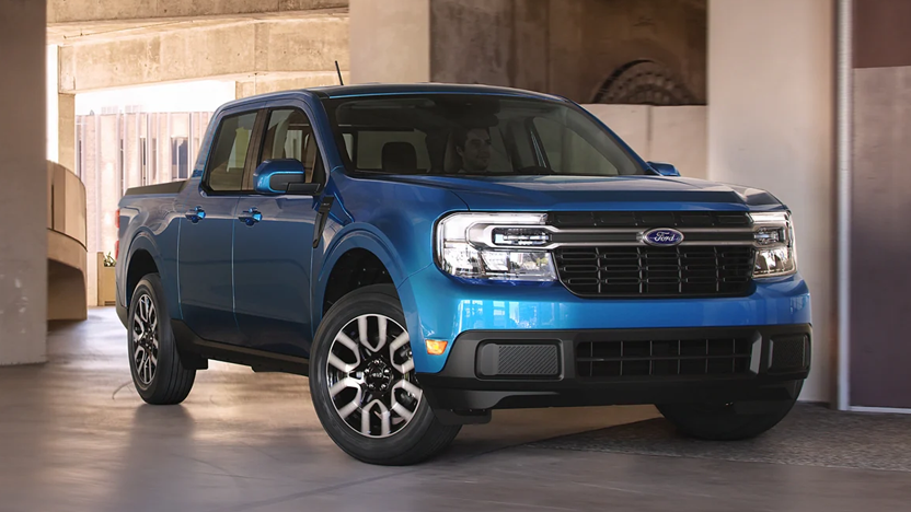2022 Ford Maverick Lariat in the color Velocity Blue parked in a parking garage