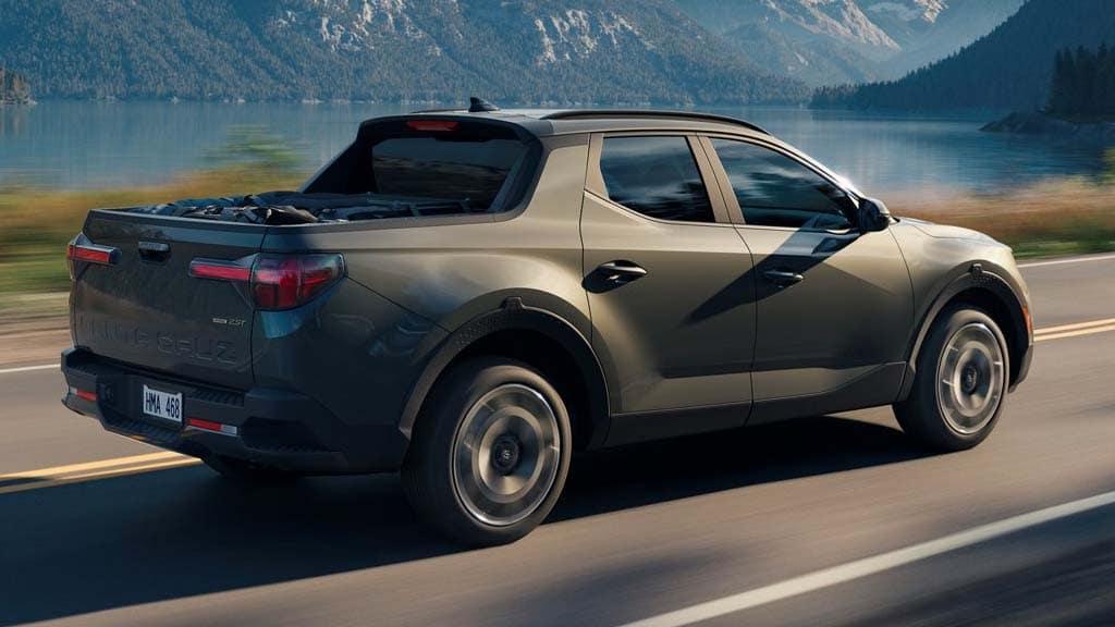 2022 Hyundai Santa Cruz in the color Sage Grey on a mountain side road.