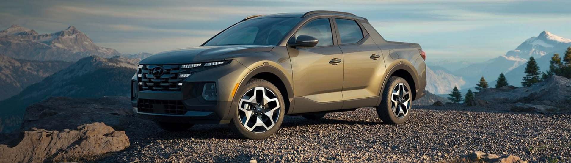 2022 Hyundai Santa Cruz in the color Sage Grey on a mountain top.
