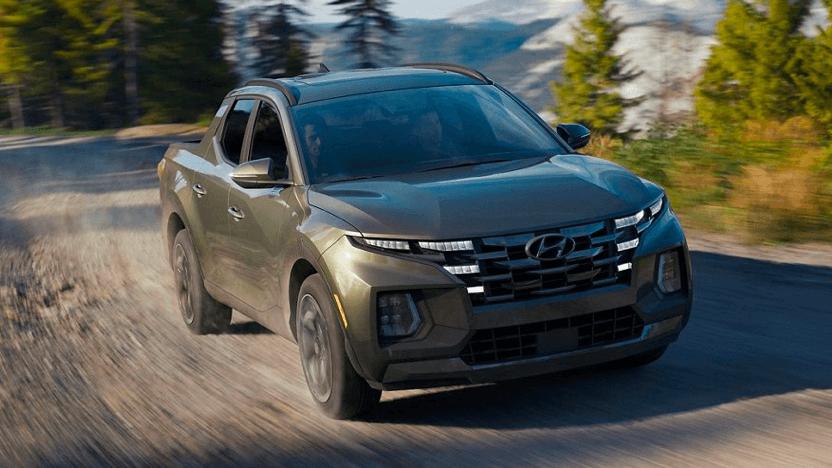 2022 Hyundai Santa Cruz in the color Sage Grey on a dirt road.