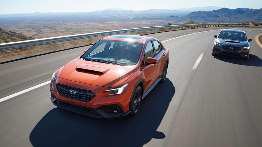 2022 Subaru WRX driving down a desert highway.