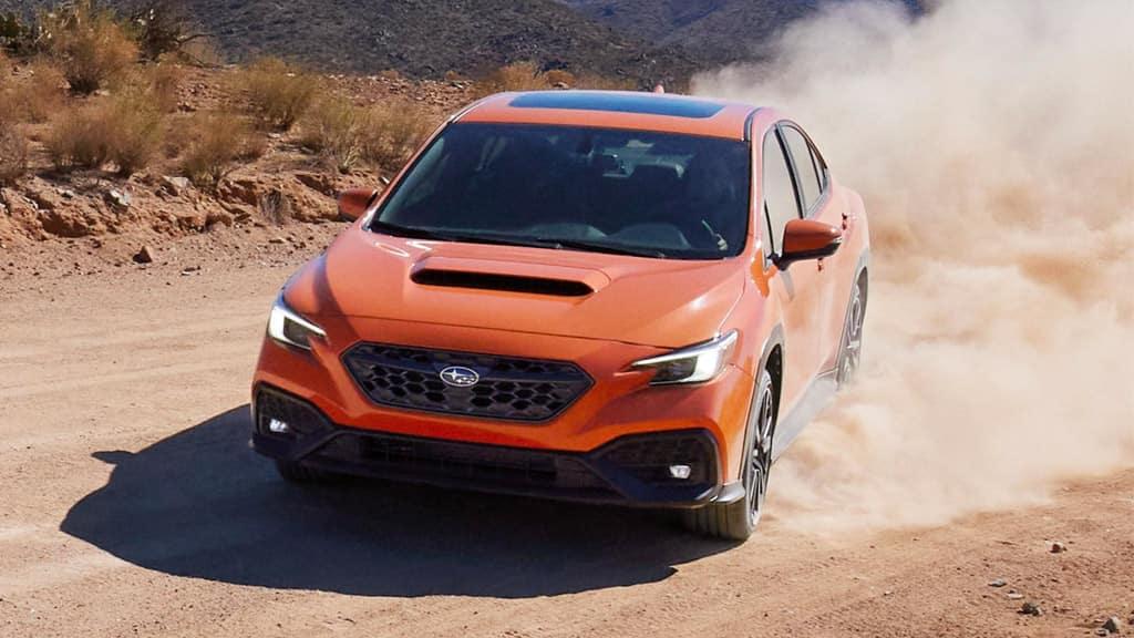2022 Subaru WRX kicking up dirt in the desert.