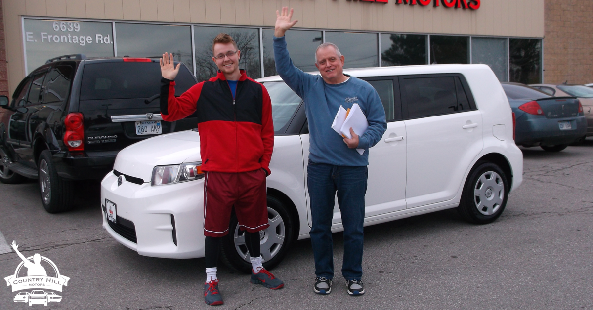 Proud buyers of a used Scion at Country Hill Motors of Kansas City