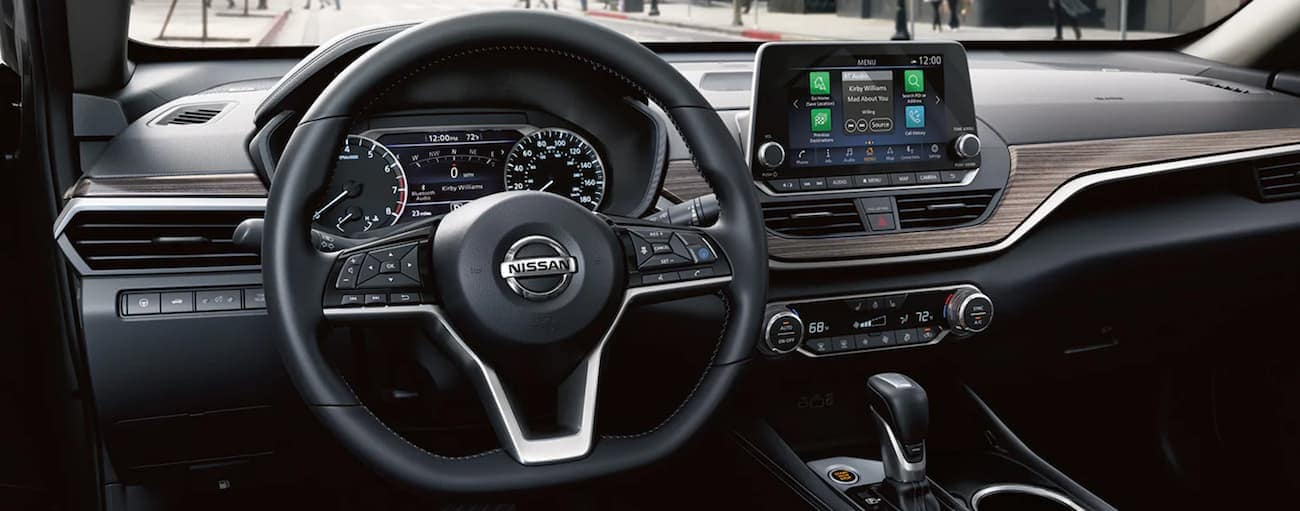 The wheel and screen are shown in a 2021 Nissan Altima.