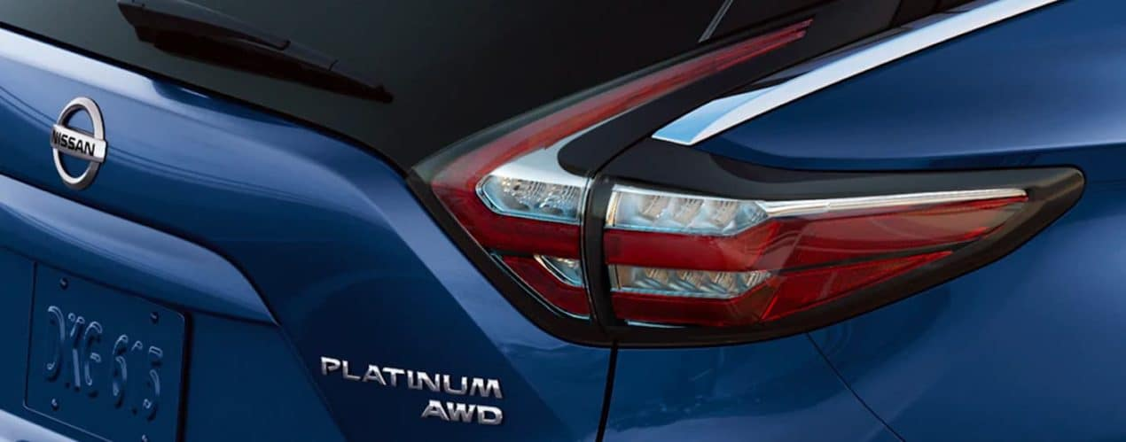A close up shows the passenger tail light on a blue 2021 Nissan Murano Platinum.