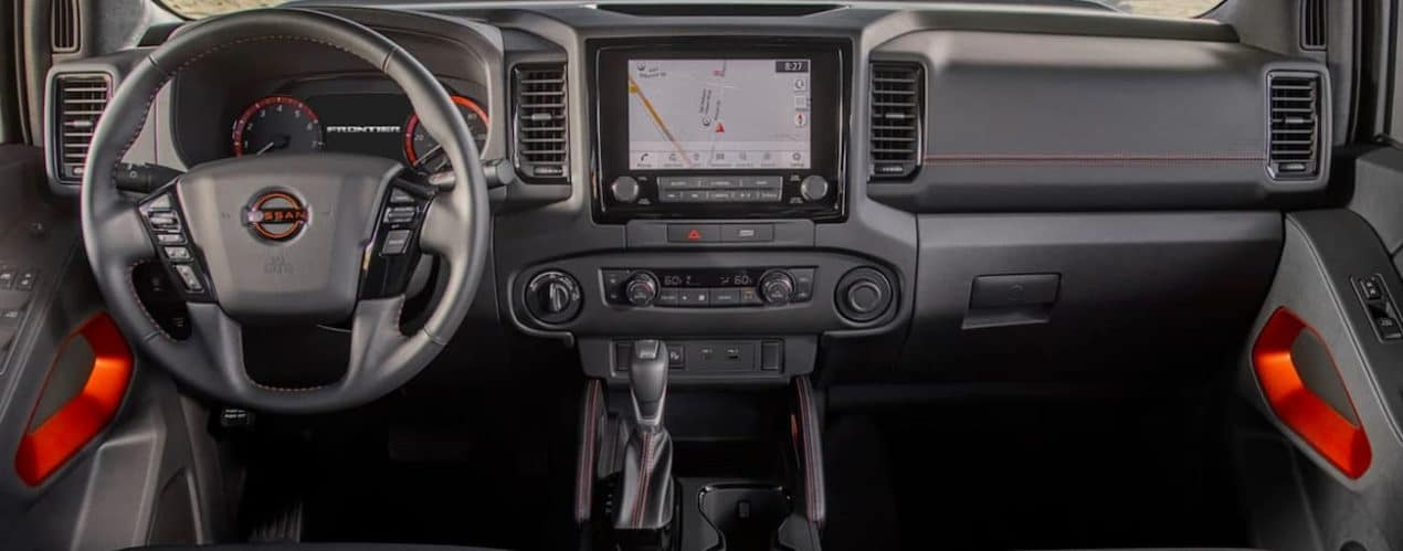 The dashboard is shown in a 2022 Nissan Frontier.