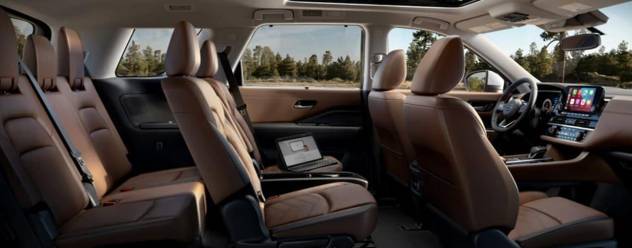 The brown interior of a 2022 Nissan Pathfinder is shown.