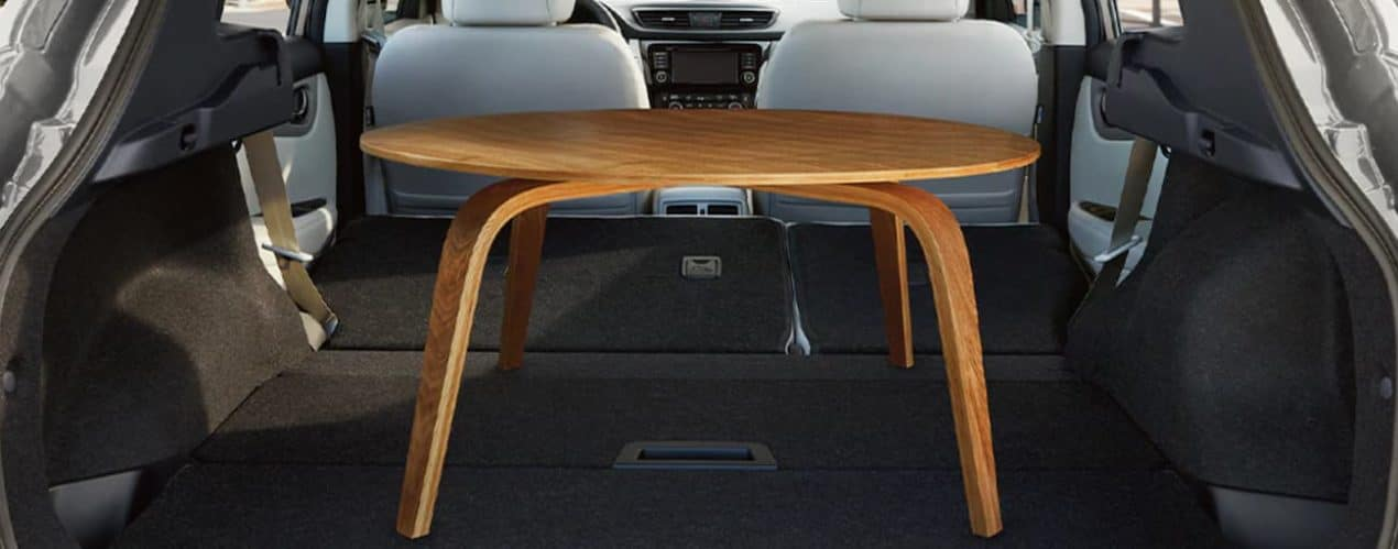 A table is shown in the cargo area of a 2021 Nissan Rogue Sport.