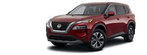 A red 2021 Nissan Rogue SV is angled left.