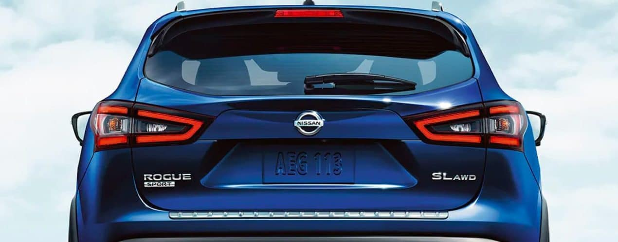 A close up shows the rear hatch and tail lights on a blue 2021 Nissan Rogue Sport SL.