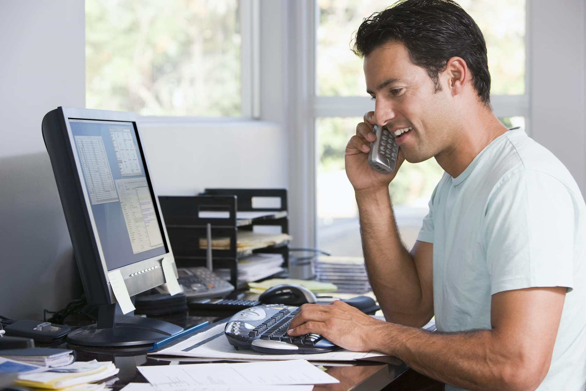 Man on the Phone in Home Office