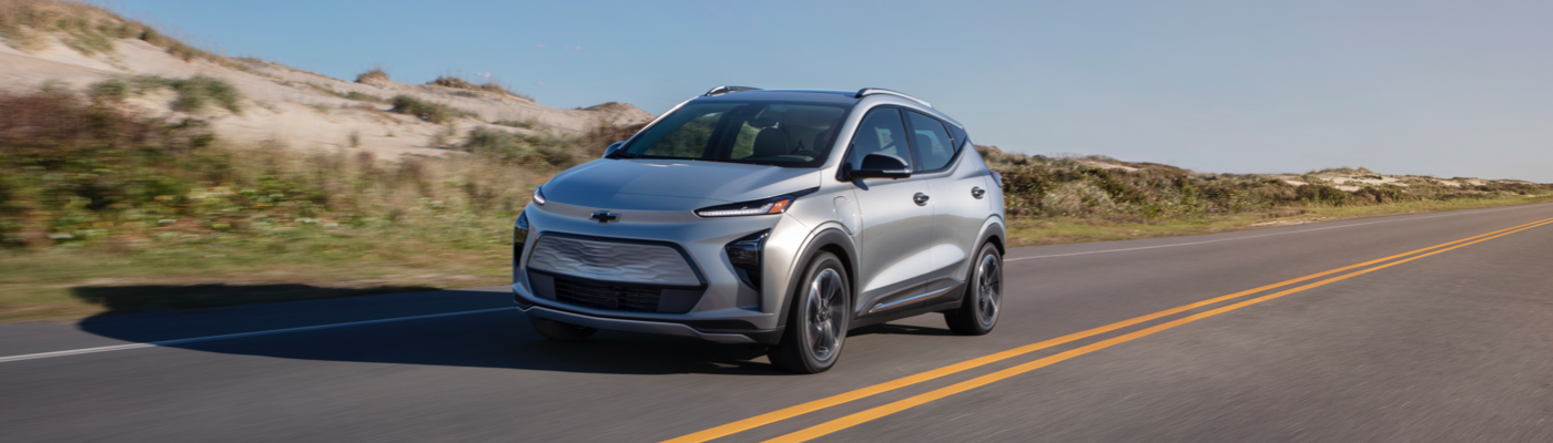 2022 Chevy Bolt EUV in Silver Flare Metallic driving down the road.