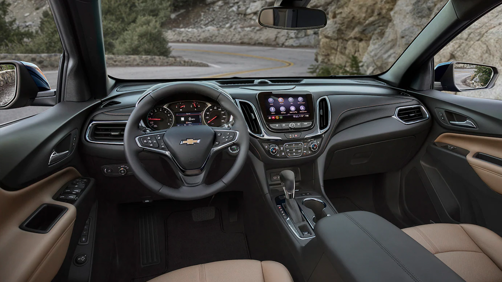 2022 Chevy Equinox wide shot of front seats, steering wheel & Infotainment system.