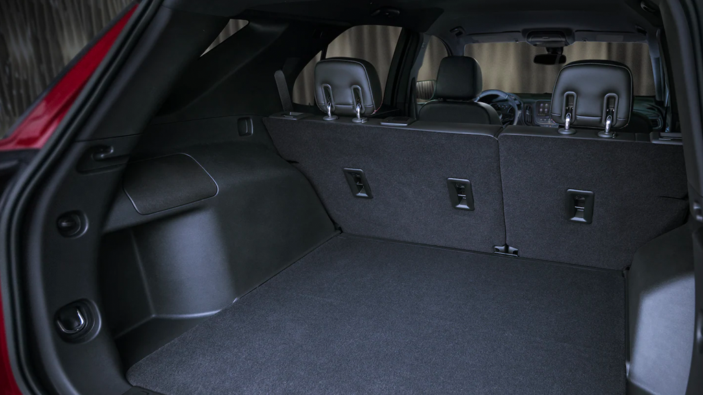 2022 Chevy Equinox with lift gate open showing available cargo space with backseats up.