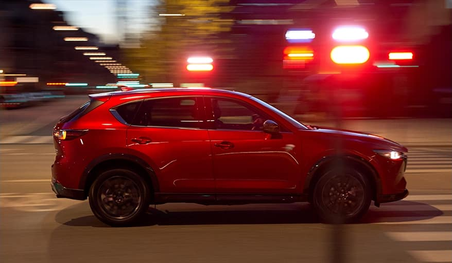 2022 Mazda CX-5 in red driving.