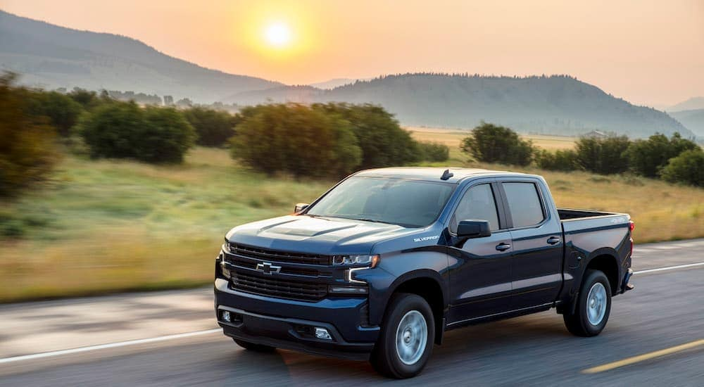 A black 2020 Chevy Silverado RST is driving down the highway after leaving a Chevy diesel truck dealer.
