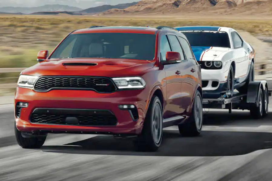 2021 Dodge Durango towing another vehicle.