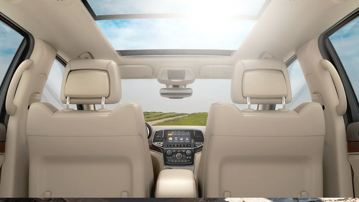 2021 Jeep Grand Cherokee interior with the sunroof open