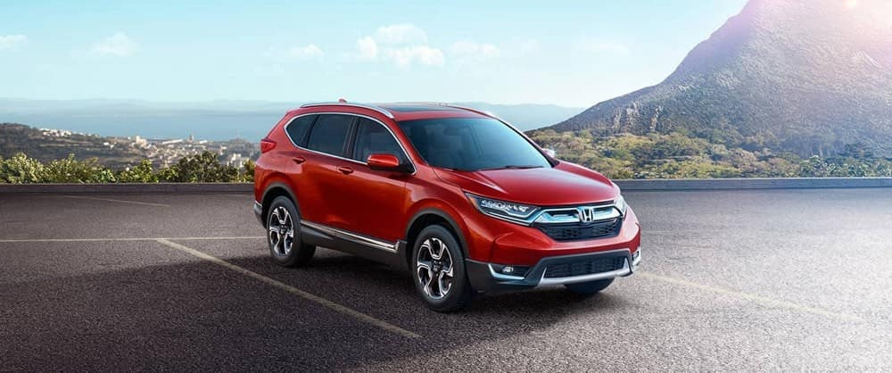 Red 2018 Honda CR-V in front of mountains