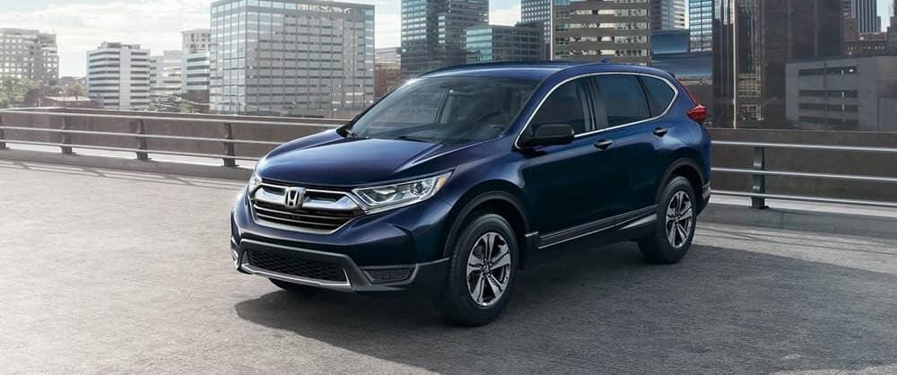 Blue Honda CR-V in city