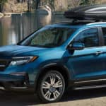 Blue 2019 Honda Pilot near lake