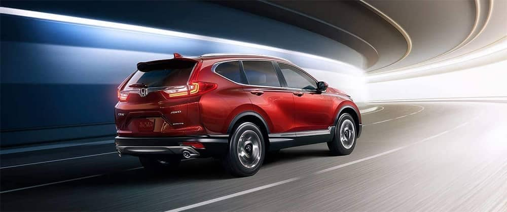 Red 2019 Honda CR-V driving through tunnel blurred background