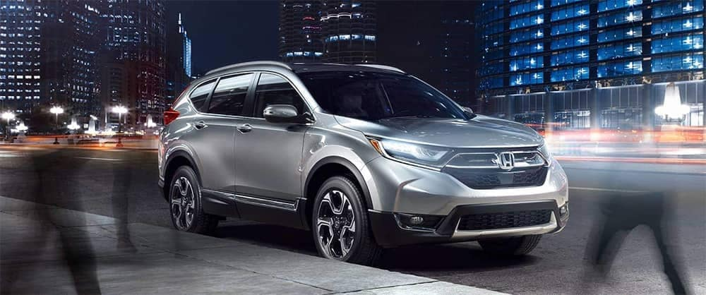 Silver Honda CR-V Parked on City Street