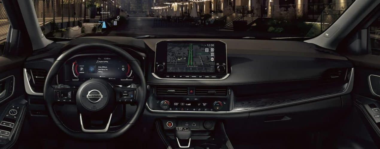 The infotainment screen in a 2021 Nissan Rogue is shown at night with GPS.