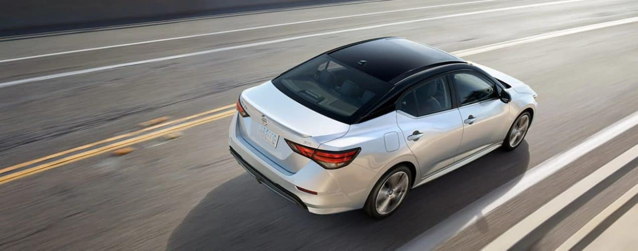 A silver 2021 Nissan Sentra is shown from above on a highway.