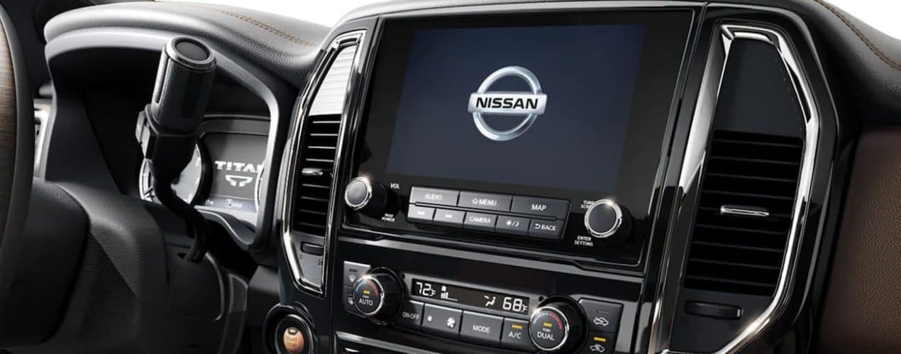 The infotainment screen is displaying the Nissan emblem in a 2021 Nissan Titan.