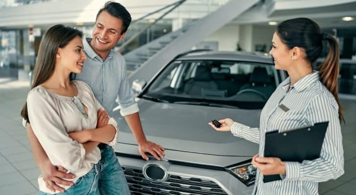 A couple is shown talking to a salesperson at a Nissan dealer in Danville.