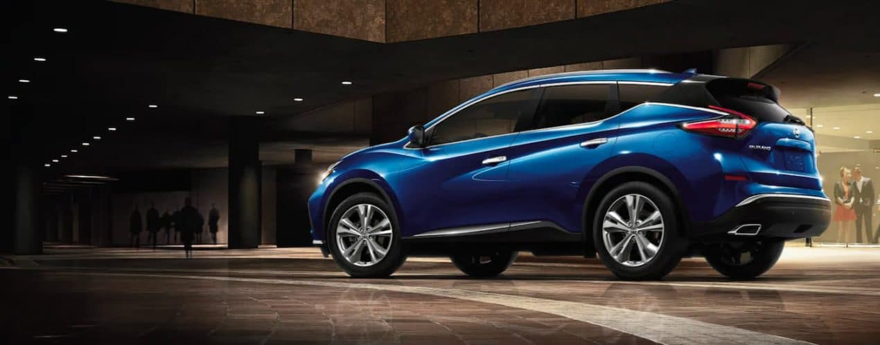 A blue 2021 Nissan Murano is shown from the side parked in an upscale foyer.