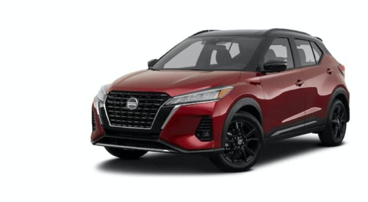 A red 2021 Nissan Kicks is angled left.