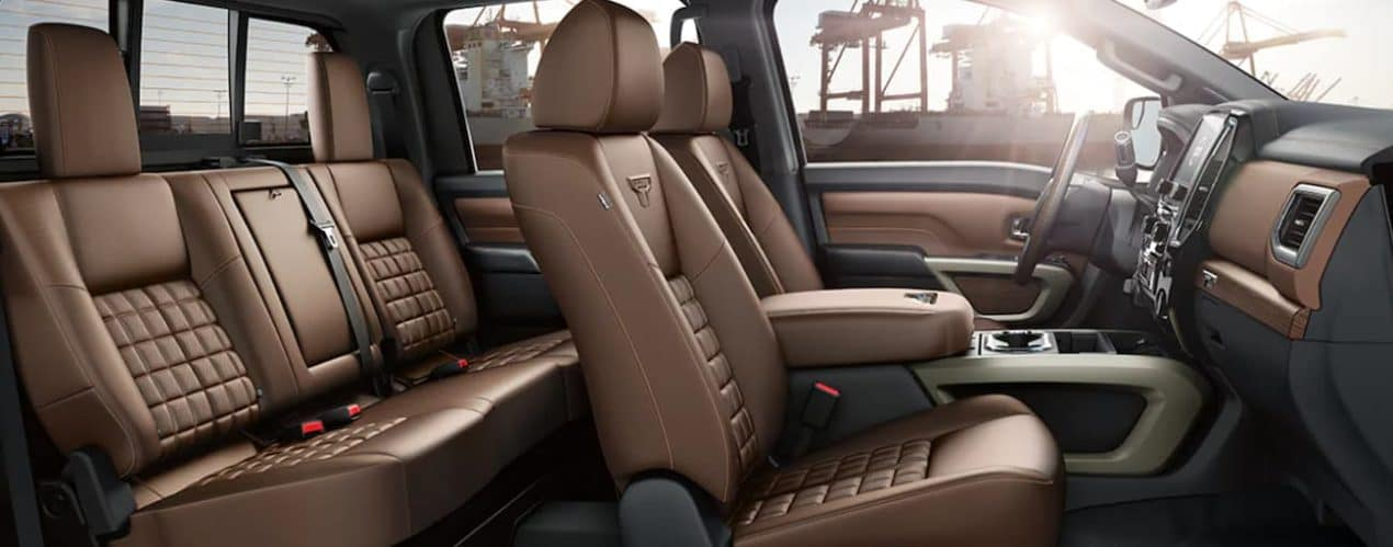 The interior of a 2021 Nissan Titan XD shows two rows of seating.