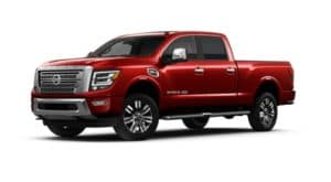 A red 2021 Nissan Titan XD is shown angled left.