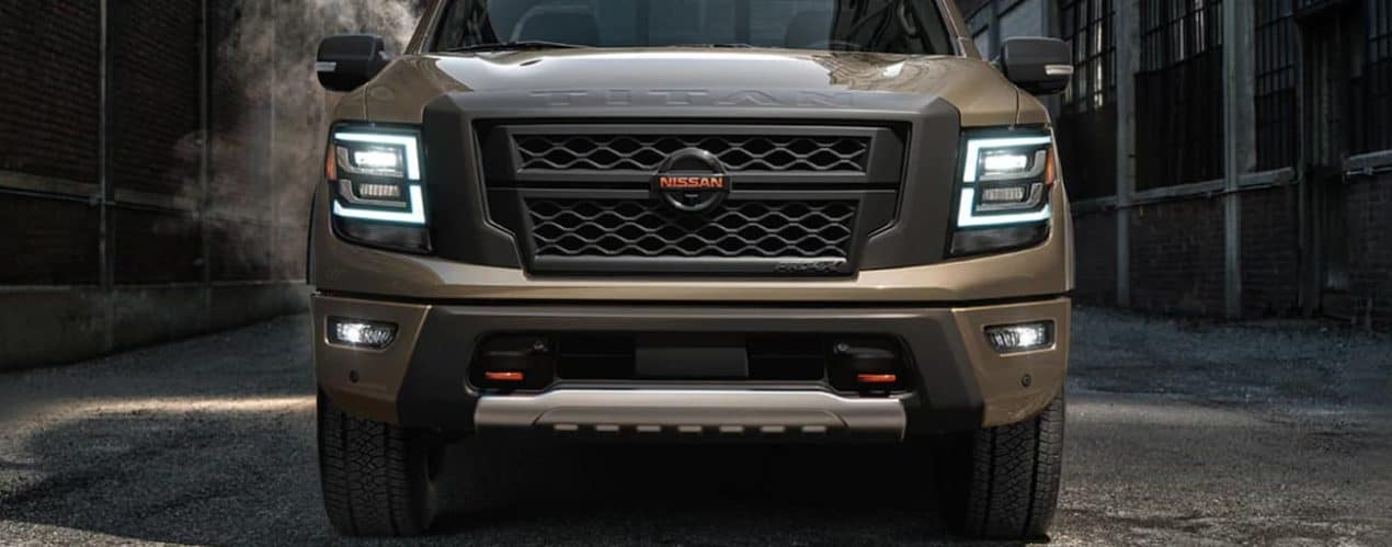 A tan 2021 Nissan Titan XD is shown from the front.