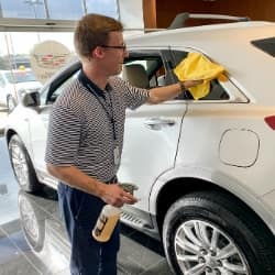 Man cleaning car exterior