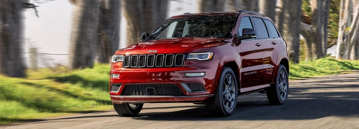 Jeep Grand Cherokee Driving Down the Road