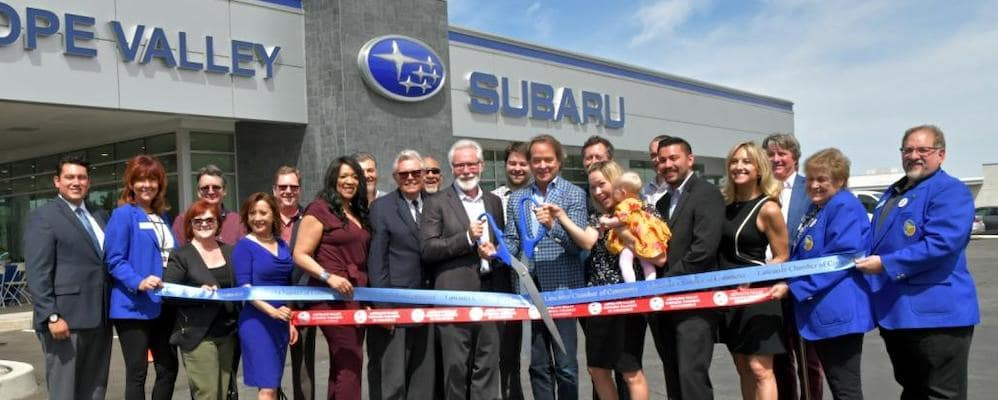 Lancaster Mayor and Mike Sullivan cutting the ribbon at Subaru Antelope Valley Expansion