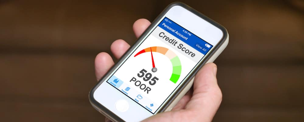 Checking credit score on phone. Bad credit score concept.