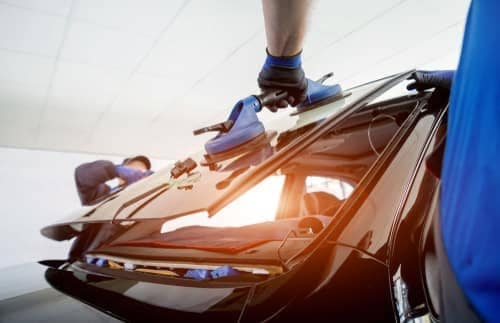 technicians install new rear car window