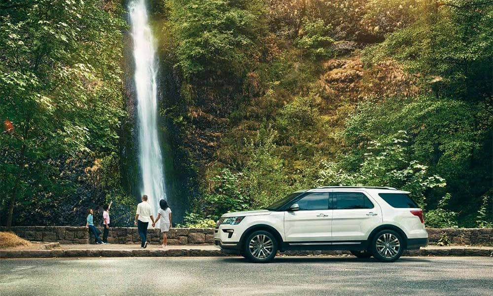 2018 Ford Explorer by a waterfall