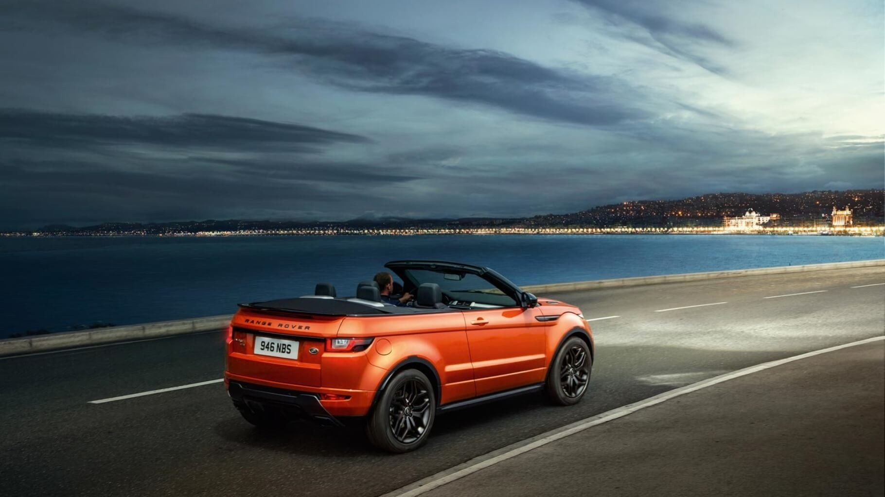 2017 Land Rover Range Rover Evoque Convertible driving on highway next to ocean