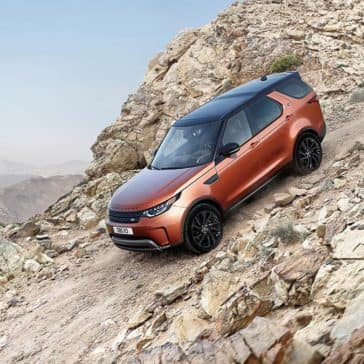 2018 Land Rover Discovery driving down a gravel hill