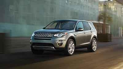 2018 Land Rover Discovery Sport driving down the road