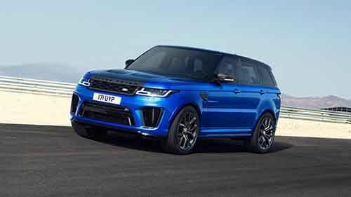 2018 Land Rover Range Rover Sport driving down the road