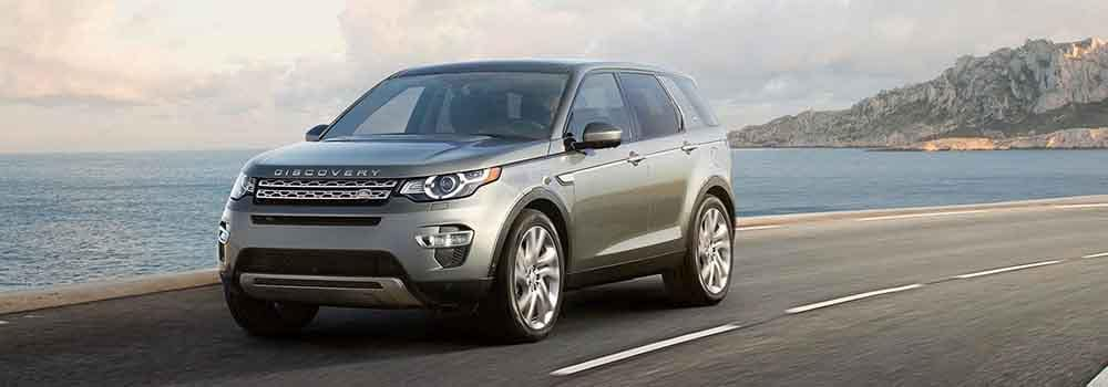 2018 Land Rover Discovery driving along the seaside